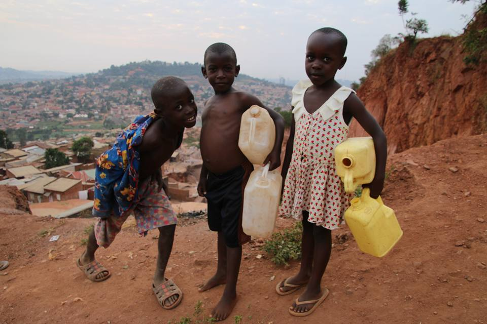 Acholi Quarter slum kampala jerry cans water kids